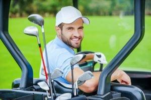 Golfer in golf cart